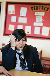 Secondary school student concentrating in a lesson,