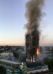 """File photo dated14/06/17 of the fire at Grenfell Tower in west London. Campaigners have called for individuals to be prosecuted over the Grenfell Tower fire after Scotland Yard said it had """"reasonable grounds"""" to suspect corporate manslaughter offences may have been committed."""