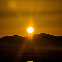 021613  Adron Gardner/Independent<br /> <br /> The sun climbs the caldera of Mount Taylor Saturday morning.  Competitors flooded downtown Grants to make their own climb to the top of the extinct volcano for the 2013 Mount Taylor Quadrathlon in Grants Saturday.