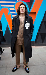 Spanish professional footballer Hector Bellerin wears a Neil Barrett  jacket, Zimmermann pyjamas and Gucci shoes during the Autumn/ Winter 2018 London Fashion Week outside the BFC Show Space, London