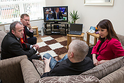 © Licensed to London News Pictures . 04/02/2014 . Sale , UK . L-R Mike Kane , Chris Bryant , Tony Gunning and Rachel Reeves . Rachel Reeves , MP for Leeds West and Shadow Secretary of State for Work and Pensions and Chris Bryant , MP for Rhondda and Shadow Minister for Welfare Reform , join Labour candidate Mike Kane on the campaign trail ahead of the Wythenshawe and Sale East by-election , following the death of MP Paul Goggins . They visit the home of Tony Gunning (51) who suffers from hereditary adult polycystic kidney disease and is on dialysis , who says he is affected by the bedroom tax . Photo credit : Joel Goodman/LNP