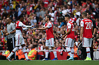 Football - 2019 Emirates Cup - Arsenal vs. Lyon<br /> <br /> Arsenal's Dani Ceballos (first left) shakes hands with Joe Willock as Unai Emery makes 3 substitutions, at the Emirates Stadium.<br /> <br /> COLORSPORT/ASHLEY WESTERN