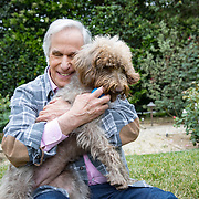 Portrait and photographs of actor and author Henry Winkler at his home in Brentwood, California with his favorite 1 year old Labradoodle, Sadie. LICENSING INQUIRIES: PLEASE CONTACT ME DIRECTLY USING THE CONTACT MENU OPTION.