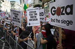 Image ©Licensed to i-Images Picture Agency. 15/07/2014. London, United Kingdom. Demonstration against BBC Israel-Palestine reporting. Protesters hold banners against the BBC in a demonstration against their way of reporting the conflict between srael-Palestine. the BBC. Picture by Daniel Leal-Olivas / i-Images