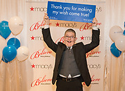Thirteen-year-old Make-A-Wish kid, Reece King, celebrates National Believe Day Friday, Dec. 11, 2015, in Macy's Oxmoor in Louisville, Ky. (Brian Bohannon/AP Images for Macy's)