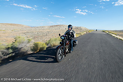 Licenced Harley-Davidson artist Scott Jacobs riding his 1926 Harley-Davidson JD on one of the rougher sections of road on the whole trip, a two-lane road in Utah on the morning of stage 11 (289 miles) of the Motorcycle Cannonball Cross-Country Endurance Run, which on this day ran from Grand Junction, CO to Springville, UT., USA. Tuesday, September 16, 2014.  Photography ©2014 Michael Lichter.