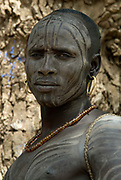 Young Man with face painted, Mursi Tribe, Mago National Park, Lower Omo Valley, Ethiopia, portrait, person, one, tribes, tribal, indigenous, peoples, Southern, ethnic, rural, local, traditional, culture, primitive,