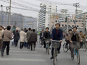China Beijing workers cycling to work in the morning