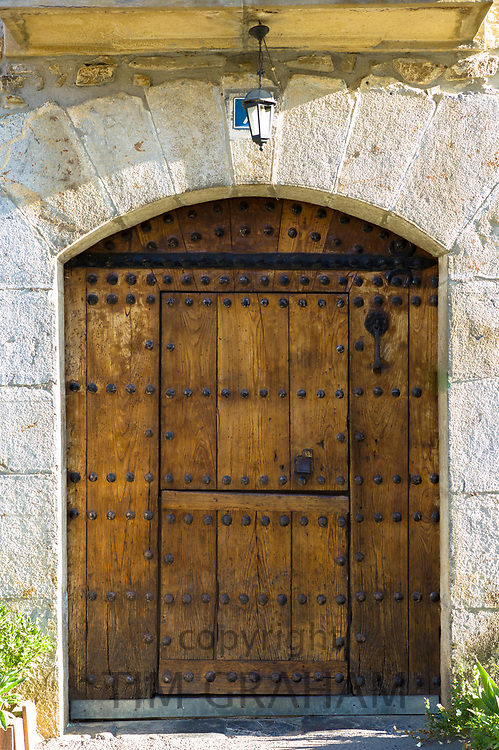 Traditional Basque architecture with studded wooden door near Orozko in the Biskaia Basque region of Northern Spain