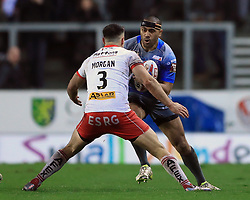 Wakefield Trinity Wildcats' Bill Tupou (right) tries to get past St Helens' Ryan Morgan during the Betfred Super League match at the Totally Wicked Stadium, St Helens.