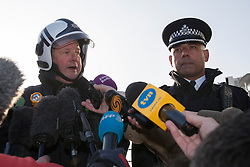 © licensed to London News Pictures. London, UK 16/01/2013. Deputy Assistant Commissioner Peter Kowup from the fire brigade (left) and Commander Neil Basu of the Metropolitan Police (right) giving a statement about the helicopter crash in Vauxhall, London. Photo credit: Tolga Akmen/LNP