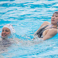 Rita Keszthelyi (L) of Hungary and Sun Huizi (R) of China fight during the women waterpolo friendly match of Hungary and China in Tatabanya, Hungary on June 23, 2012. ATTILA VOLGYI