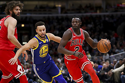 January 17, 2018 - Chicago, IL, USA - Chicago Bulls guard Jerian Grant (2) drives past Golden State Warriors guard Stephen Curry (30) during the first half at the United Center in Chicago on Wednesday, Jan. 17, 2018. The Warriors won, 119-112. (Credit Image: © Armando L. Sanchez/TNS via ZUMA Wire)