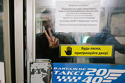 March 17, 2020, Kiev, Ukraine: A police officer closes the Botanical Garden metro station for quarantine. Ukraine announced shutdowns of public transport, bars, restaurants and shopping malls to stem the spread of the coronavirus after President Zelensky promised to act ''harshly, urgently, perhaps unpopularly''. The government supported Zelensky's proposals and introduced restrictions on domestic movement, including full closure of the country's three metro systems until April 3. (Credit Image: © Pavlo Pakhomenko/NurPhoto via ZUMA Press)