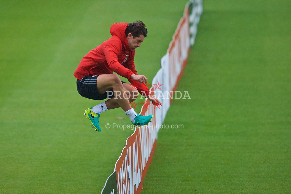 CARDIFF, WALES - Saturday, June 10, 2017: Wales' Joe Walsh leaps an advertising hoarding during a training session at the Vale Resort ahead of the 2018 FIFA World Cup Qualifying Group D match against Serbia. (Pic by David Rawcliffe/Propaganda)