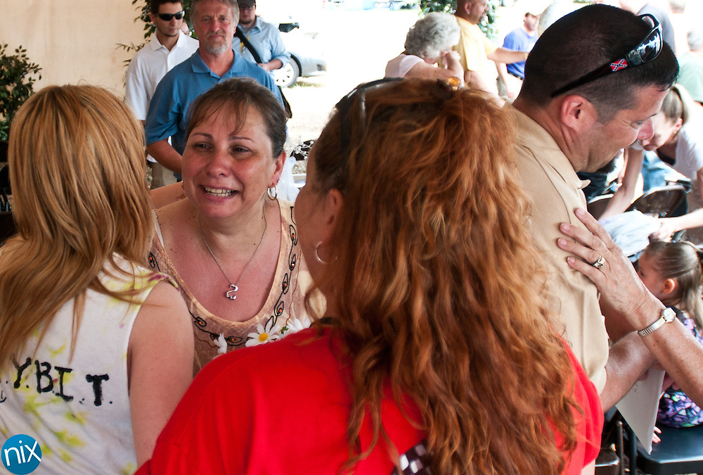 Linda and Greg Waters are congratulated by friends after getting married in a camp ground outside of Charlotte Motor Speedway Friday afternoon. The couple met at the camp ground a year ago and decided to get married on their one-year anniversary since most of their family and friends would already be at the speedway. (Photo by James Nix)