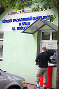 Withdrawing Zloty, Polish currency, from a bankomat using a credit card at the Sports Training Center. Spala Central Poland