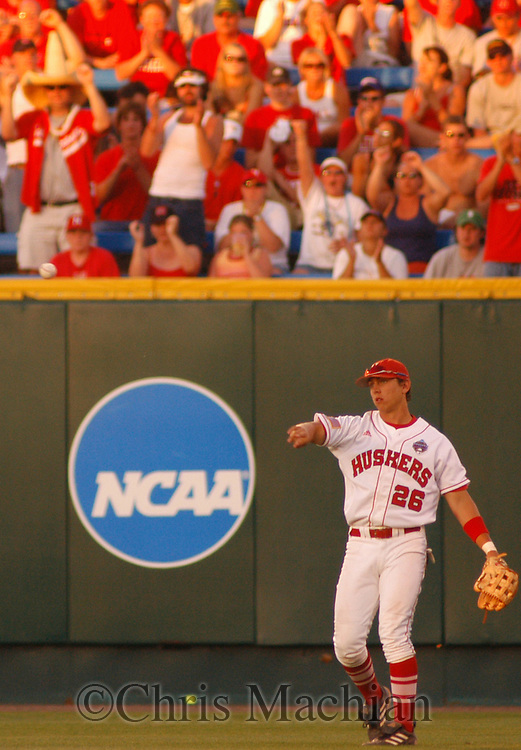 6/17/2005 -- Omaha, NE.The BIG RED as No. 3 Nebraska vs. Arizona State in the College World Series.UNIV OF Nebraska's Andy Gerch throws a ball in from right field during the seventh inning...(photo by Chris Machian/Machian Photo)