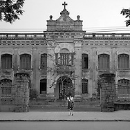 Students in front of an ancient Catholic french school in hue, Vietnam. 2005
