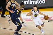 Golden State Warriors guard Klay Thompson (11) handles the ball against the Utah Jazz at Oracle Arena in Oakland, Calif., on December 27, 2017. (Stan Olszewski/Special to S.F. Examiner)