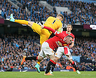 Joe Hart of Manchester City collects the ball under pressure from Wayne Rooney of Manchester United - Barclays Premier League - Manchester City vs Manchester Utd - Etihad Stadium - Manchester - England - 2nd November 2014  - Picture David Klein/Sportimage