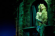 """Sasha Martin, playing the part of Rapunzel, rehearses a scene from Hickory High's performance of Stephen Sondheim's """"Into the Woods""""."""