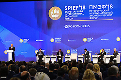 Russian President Vladimir Putin, Christine Lagarde, managing director of the International Monetary Fund (IMF), Japanese Prime Minister Shinzo Abe and French President Emmanuel Macron attending a session of the Saint Petersburg International Economic Forum on May 25, 2018 in Saint Petersburg.Photo by Christian Liewig/ABACAPRESS.COM