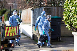 © Licensed to London News Pictures.23/02/2021. London, UK. Forensic officers gather evidence at a crime scene where a murder investigation is underway in Ealing, west London. Met Police were called to reports of an unresponsive woman yesterday at 3:47pm. The victim was pronounced dead at the scene. A man has been arrested on suspicion of murder. Photo credit: Marcin Nowak/LNP