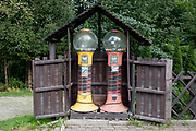 A landscape of two sweets (confectionary) dispensers on a residential street, on 16th September 2019, in Zakopane, Malopolska, Poland.
