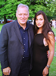 MR & MRS DAVE GILMOUR, he is the musician, at a party in London on 7th July 1999.MUC 58