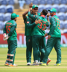 Bangladesh's Mosaddek Hossain (centre No32) celebrates after taking the wicket of New Zealand's Corey Anderson during the ICC Champions Trophy, Group A match at Sophia Gardens, Cardiff.