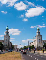 View of Frankfurter Tor historic landmark with TV Tower to rear on Karl Marx Allee in former East Berlin Germany