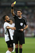 Referee Manuel Grafe gives a yellow card to Junior Morais, of Astra Giurgiu captain for diving. UEFA Europa league, 1st play off round match, 2nd leg, West Ham Utd v Astra Giurgiu at the London Stadium, Queen Elizabeth Olympic Park in London on Thursday 25th August 2016.<br /> pic by John Patrick Fletcher, Andrew Orchard sports photography.