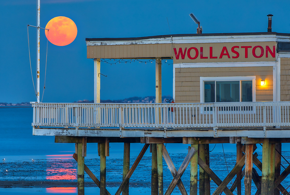 Coastal Massachusetts seascape and Worm full moon photography over the Wollaston Yacht Club located Quincy Shore Drive in Quincy, MA. Originally I made other plans to photograph this full moon rise but changed plans quickly when I realized I would not make it to the location on time. Glad traffic was a disaster that day and forced me to improvise and stop at the Wollaston Yacht Club in Quincy, Massachusetts.<br /> <br /> Massachusetts Worm full moon photography images of Wollaston Yacht Club located Quincy Shore Drive in Quincy, MA are available for image licensing and as museum quality photography prints, canvas prints, acrylic prints, wood prints or metal prints. Wall art prints may be framed and matted to the individual liking and room decor needs:<br /> <br /> https://juergen-roth.pixels.com/featured/worm-full-moon-over-the-wollaston-yacht-club-on-quincy-shore-drive-juergen-roth.html<br /> <br /> Good light and happy photo making! <br /> <br /> My best, <br /> <br /> Juergen