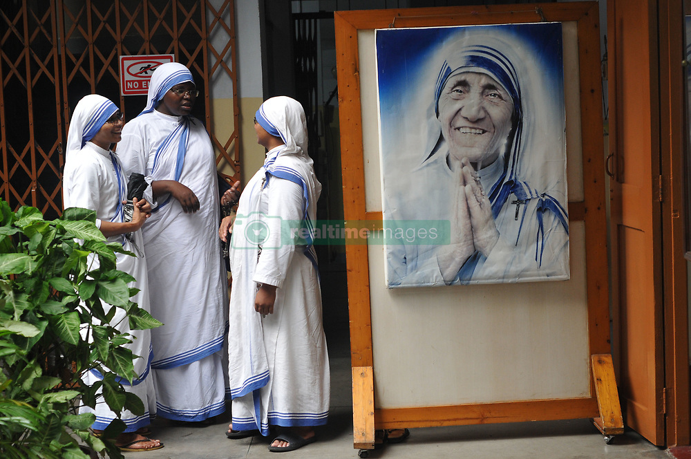 September 5, 2017 - Kolkata, West Bengal, India - Roman Catholic nuns of the Missionaries of Charity join  pray at a service to commemorate the 20th death anniversary of Mother Teresa at the Missionaries of Charity house in Kolkata. Pope Francis on September 4, 2016 proclaimed Mother Teresa a saint, hailing her work with the destitute of Kolkata as a beacon for mankind and testimony of God's compassion for the poor. The revered nun's elevation to Roman Catholicism's celestial pantheon came in a canonisation mass in St Peter's square presided over by Pope Francis. (Credit Image: © Debajyoti Chakraborty/NurPhoto via ZUMA Press)