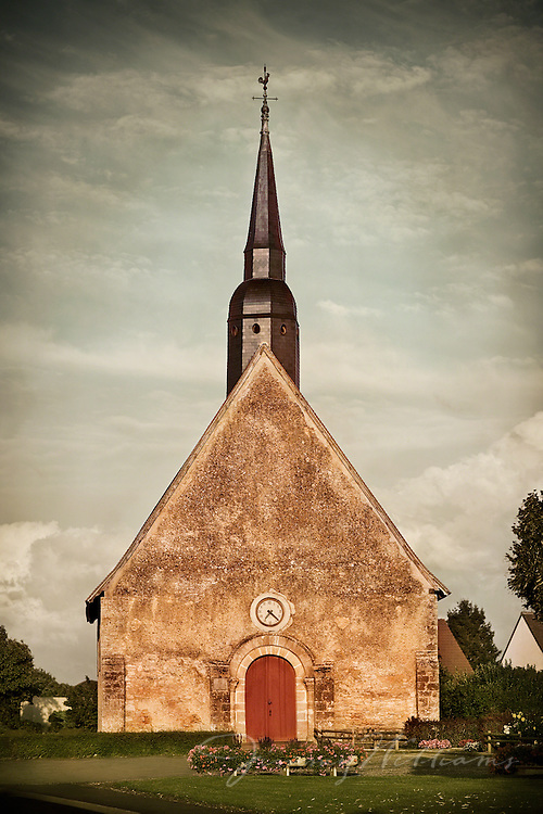 An old stone chapel with large metal steeple, located in the Loire Valley region of France