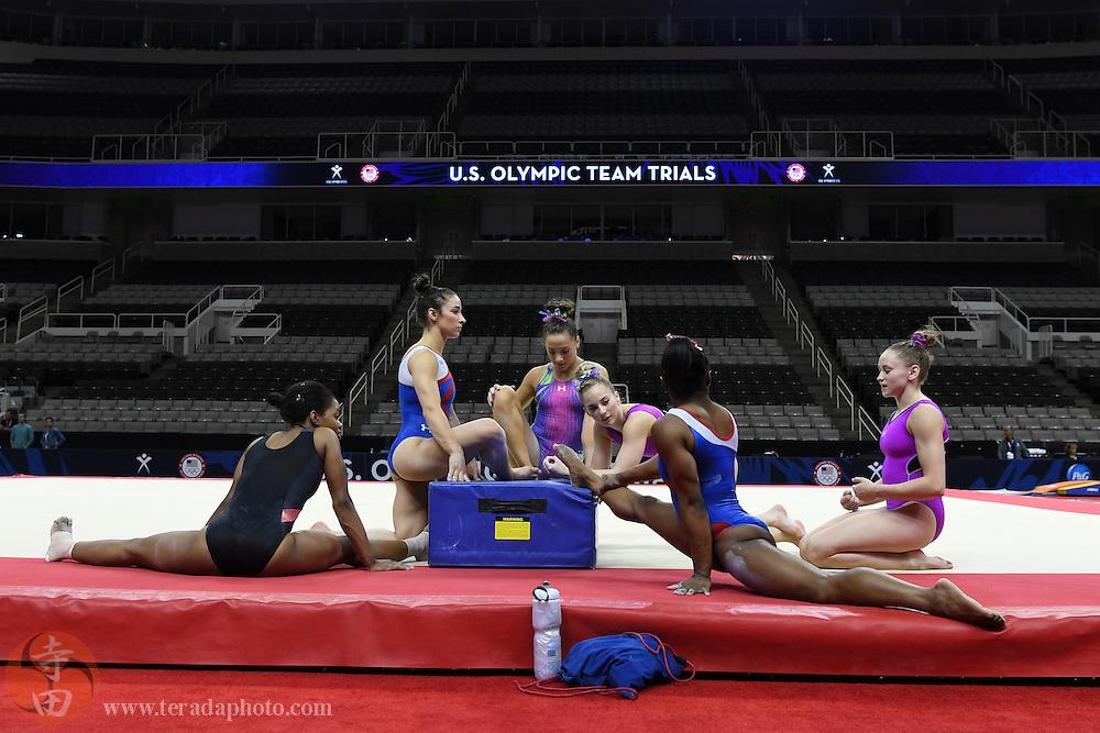 July 7, 2016; San Jose, CA, USA; (L-R) Gabby Douglas, Aly Raisman, Amelia Hundley, MyKayla Skinner, Simone Biles, and Rachel Gowey stretch during the women's gymnastics U.S. Olympic team trials training at SAP Center at San Jose.