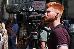 © Licensed to London News Pictures. 14/06/2021. London, UK. A GB NEWS  camerman shoot video footage at the anti lockdown and anti Covid vaccination demonstration outside Downing Street. Later today the British Prime Minister will hold a press conference and announce his decision on lockdown easing. Photo credit: Ray Tang/LNP