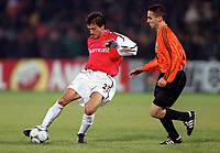 Nelson Vivas (Arsenal) Marian Aliuta (Shakhtar Donetsk). Shakhtar Donetsk 3:0 Arsenal, UEFA Champions League, Group B, Centralny Stadium, Donetsk, Ukraine, 7/11/2000. Credit Colorsport / Stuart MacFarlane.