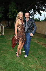 KIM HERSOV and fashion designer ROLAND MOURET at the annual Serpentine Gallery Summer Party co-hosted by Jimmy Choo shoes held at the Serpentine Gallery, Kensington Gardens, London on 30th June 2005.<br /><br />NON EXCLUSIVE - WORLD RIGHTS