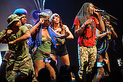 """WASHINGTON, DC - October 2nd, 2014 - Big Freedia (right, with mic) performs at the Howard Theatre in Washington, D.C.  Freedia is credited with bringing New Orleans """"bounce music"""" to the masses. His latest album, Just Be Free, was released in June. (Photo by Kyle Gustafson/For The Washington Post)"""