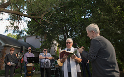 September 29, 2018 - Toronto, ON, Canada - TORONTO, ON - SEPTEMBER 29: Karen Fraser (left, head bowed) and Ron Smith (right), participate in a renewal ceremony at their home - 53 Mallory Cres. The property is linked to victims of alleged serial killer Bruce McArthur were discovered. Rev. Helena-Rose Houldcroft, finishes a reading.   Toronto Star/Rick Madonik Rick Madonik/Toronto Star (Credit Image: © Toronto Star/The Toronto Star via ZUMA Wire)