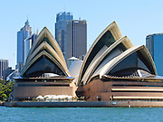 """Sydney Opera House was opened in 1973 on Bennelong Point in Sydney Harbour, Sydney, New South Wales (NSW), Australia. It was conceived and largely built by Danish architect Jørn Utzon after a long gestation starting with his competition-winning design in 1957. Utzon received the Pritzker Prize, architecture's highest honor, in 2003: """"There is no doubt that the Sydney Opera House is his masterpiece… one of the great iconic buildings of the 20th century, an image of great beauty that has become known throughout the world – a symbol for not only a city, but a whole country and continent."""" The Sydney Opera House was honored as a UNESCO World Heritage Site in 2007. Published in """"Light Travel: Photography on the Go"""" book by Tom Dempsey 2009, 2010."""