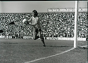 League of Ireland vs Liverpool FC.    (M87)..1979..18.08.1979..08.18.1979..18th August !979..In a pre season friendly the League of Ireland took on Liverpool FC at Dalymount Park Phibsborough,Dublin. The league team was made up of a selection of players from several League of Ireland clubs and was captained by the legendary John Giles. Liverpool won the game by 2 goals to nil..The scorers were Hansen and McDermott...Ray Clemence is in control of the ball as he prepares to clear upfield.