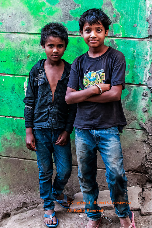 Friends: In the heart of their shanty town, two good friends stop to be photographed, Jammu India.