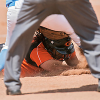 051113       Cable Hoover<br /> <br /> Gallup Bengal Mattea Lavato tries to avoid the tag from the Goddard Rockets as she dives for second base during the first round of the state tournament at Gallup High School Saturday.