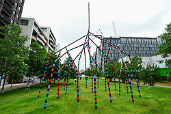 "© Licensed to London News Pictures. 16/07/2020. LONDON, UK.  ""My World and Your World"", by major contemporary London-based, Irish artist Eva Rothschild, is unveiled.  The new 16m high public sculpture in Lewis Cubitt Park in King's Cross resembles a lightning bolt, painted in black, purple, pink, orange, green and red stripes.  The coronavirus lockdown caused the April 2020 launch to be postponed, but the unveiling has been able to go ahead now that certain lockdown restrictions have been eased by the UK government.  Photo credit: Stephen Chung/LNP"