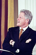 US President Bill Clinton laughs during a White House event February 17, 1999 in Washington, DC.