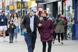 © Licensed to London News Pictures. 11/10/2020. London, UK. Shoppers wearing face coverings in Wood Green, north London as another national coronavirus lockdown looms. <br /> SADIQ KHAN, Mayor of London has warned that a London lockdown cannot be ruled out as coronavirus cases in the capital soar. In a statement to MPs on Monday, 12 Oct 2020, Prime Minister Boris Johnson is expected to announce tougher local restrictions, outlining plans for a three-tier system, where each region in England is placed into a tier based on the severity of cases in the area. Photo credit: Dinendra Haria/LNP