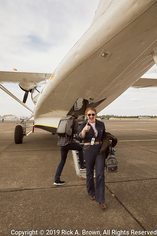 One of our event planners unloading from the PBY-5a Catalina unloading at Warbirds Over the West.